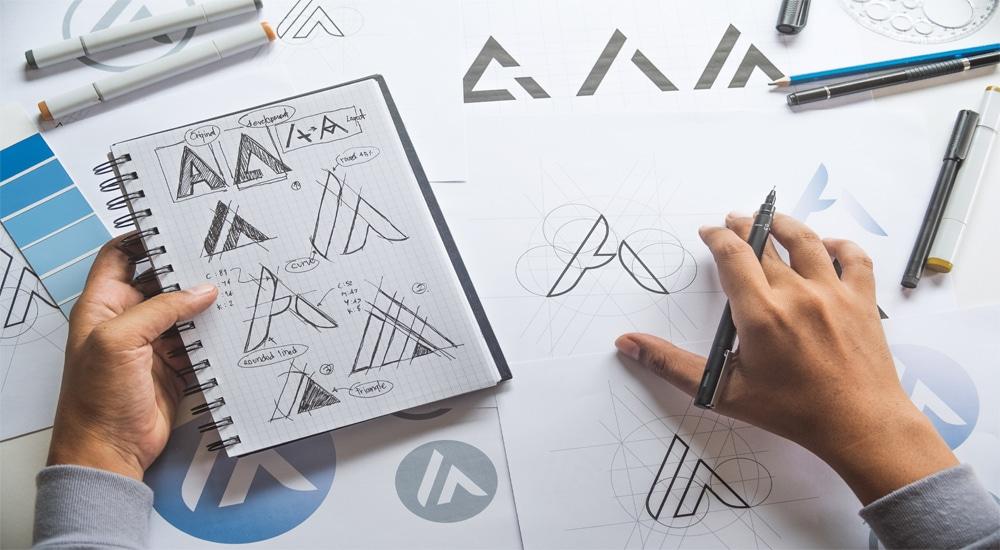 designer looking at logo designs